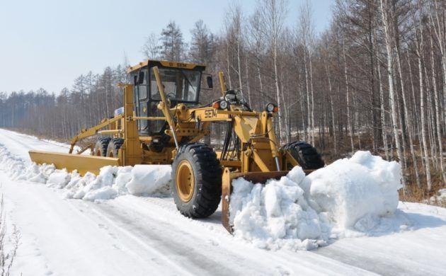 Уборка снега грейдером